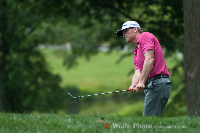 James Driscoll chipping a shot up to the green from the steep approach on the hill to the 9th hole.