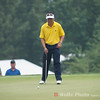Charlie Wi waiting his turn to putt in the rain during the 4th round of the 2013 AT&T National.
