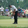Andres Romero putting on the 9th during the 4th round of the AT&T National golf tournament.