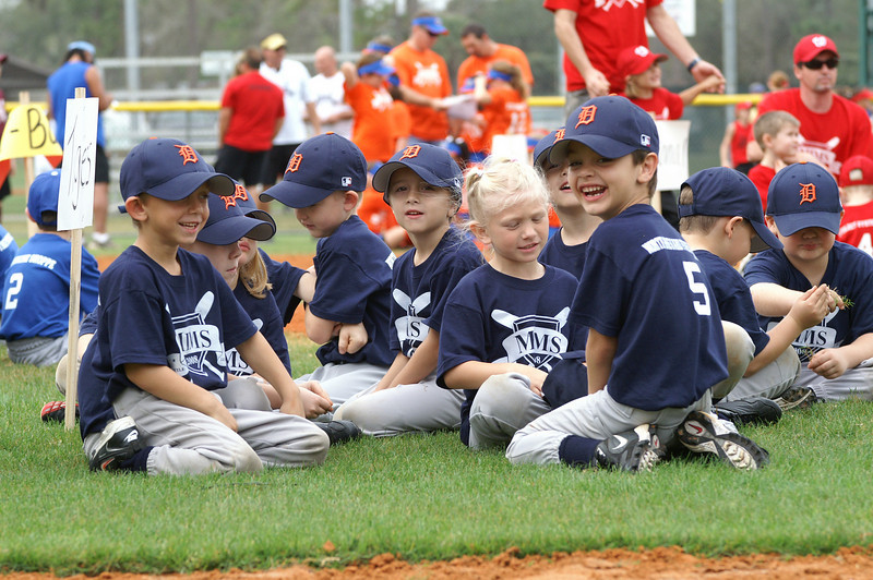 All smiles.  Tyler Coop and Gavin O'Brien (in front) smile big for the crowd at Mims Little League opening day ceremony on Saturday, February 23, 2008.  Rick Andrews, for FLORIDA TODAY.