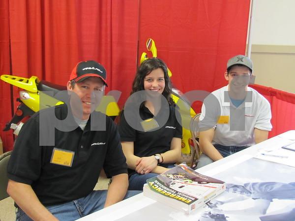 Jeff, Cassie, and Sean Schneider of Pocahontas Sales & Service.