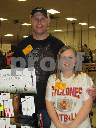 Jeremy and Bailey Lindley in their booth at the Sports Show held at the Webster County Fairgrounds.