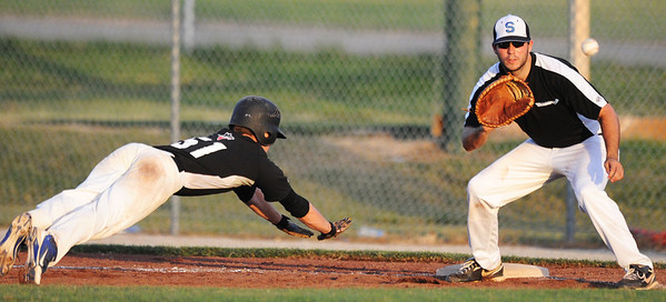 Globe/T. Rob Brown<br /> Outlaws runner (51) returns safely to first base during a pickoff attempt Wednesday evening, June 12, 2013, at Joe Becker Stadium.