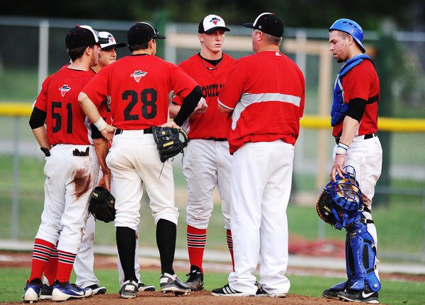 Globe/T. Rob Brown<br /> Joplin Outlaws infielders, catcher and a coach speak to the pitcher at the mound during the Sedalia Bombers game Thursday evening, June 20, 2013, at Joe Becker Stadium.