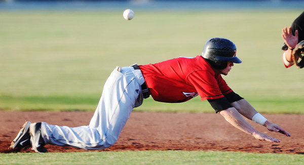 Globe/T. Rob Brown<br /> St. Joseph Mustangs shortstop Michael Schulze dives back to second base as the ball flies overhead Monday evening, June 10, 2013, at Joe Becker Stadium. Schulze has been drafted by the Cardinals.
