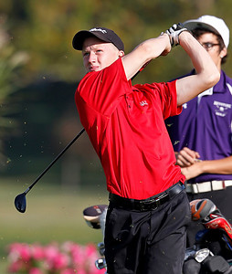 Lutheran West's Mike Clum tees off on the fourth hole during the PAC Tournament Thursday at Eagle Creek Golf Club. (RON SCHWANE / CT)