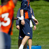 Denver Broncos quarterback Peyton Manning joins players during the team's minicamp at Broncos headquarters in Englewood, Colo., on Monday, May 21, 2012. (AP Photo/David Zalubowski)
