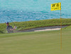 Webb Simpson making a sand save on 16th during round 1 on Tuesday