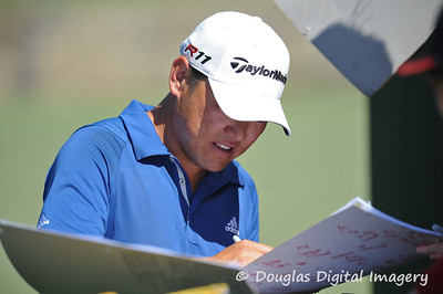 Charlie Wi signs an autograph after his practice round on Wednesday before the beginning of the PGA Championships at the Atlanta Athletic Club in Johns Creek, GA.