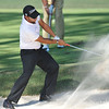 A golfer blasts a shot out of the sand trap during the practice rounds on Wednesday before the beginning of the PGA Championships at the Atlanta Athletic Club in Johns Creek, GA.