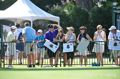 Eager fans wait patiently in the heat for an autograph during the practice rounds on Wednesday before the beginning of the PGA Championships at the Atlanta Athletic Club in Johns Creek, GA.