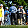 Vijay Singh talks to PGA officials while David Toms and Phil Mickelson wait to tee off on Thursday during the first round of the PGA Championships at the Atlanta Athletic Club in Johns Creek, GA.
