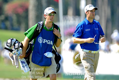 Ross Fisher walks down the fairway with his caddie on Thursday during the first round of the PGA Championships at the Atlanta Athletic Club in Johns Creek, GA.