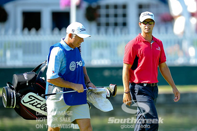 Adam Scott walks with his Caddie Steve Williams on the #18 fairway on Thursday during the first round of the PGA Championships at the Atlanta Athletic Club in Johns Creek, GA.