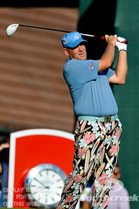 John Daly loosens up with his colorful pants before teeing off on Thursday during the first round of the PGA Championships at the Atlanta Athletic Club in Johns Creek, GA.
