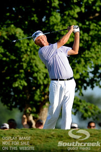 Davis Love III watches his tee shot during his follow through on Thursday during the first round of the PGA Championships at the Atlanta Athletic Club in Johns Creek, GA.