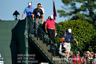 Tiger Woods heads down the stairs towards the 10th tee box on Thursday during the first round of the PGA Championships at the Atlanta Athletic Club in Johns Creek, GA.