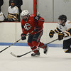 RYAN HUTTON/ Staff photo. <br /> Andover's Conor O'Reilly (8) tries to snag the puck from Central Catholic's William Stahley (21) during the third period of Tuesday's game. Central Catholic won 9-1.