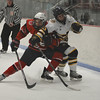 RYAN HUTTON/ Staff photo. <br /> Central Catholic's Christian Thompson (7) collides with Andover's Mark Campbell (13) as they both dash for the puck during Tuesday's game. Central Catholic won 9-1.