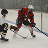 RYAN HUTTON/ Staff photo. <br /> Central Catholic's Adam Bibeau (20) and Andover's Thomas Mapstone (17) compete for the puck during the second period of Tuesday's game. Central Catholic won 9-1.