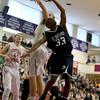 Central Catholic's Aaron Hall blocks a shot attempt by St. John's Prep player Kareem Davis (33).
