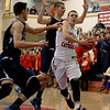 Central Catholic's Tyler Nelson drives to the basket against the St. John's Prep defense during their game in Lawrence.