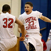 Central Catholic's Kevin Fernandez (23) celebrates with Alex Santos after defeating St. John's Prep, 63-60 in Lawrence.