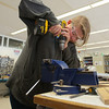 RYAN HUTTON/ Staff photo. <br /> Dominique Bridges, 16, drills a hole in a mounting bracket for the Whittier Tech robotics team robot.