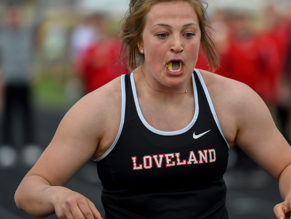 . Loveland\'s Moira Dillow scarfs up a banana at the end of the exhibition 4x50 meter relay during the R2J Meet on Thursday April 12, 2018 at LHS. (Cris Tiller / Loveland Reporter-Herald)