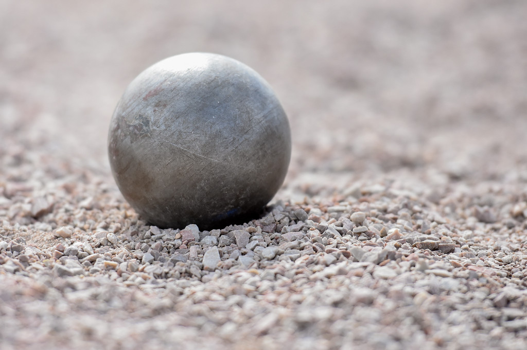 . A shot put rests in the pit after being thrown during the R2J Meet on Thursday April 12, 2018 at LHS. (Cris Tiller / Loveland Reporter-Herald)