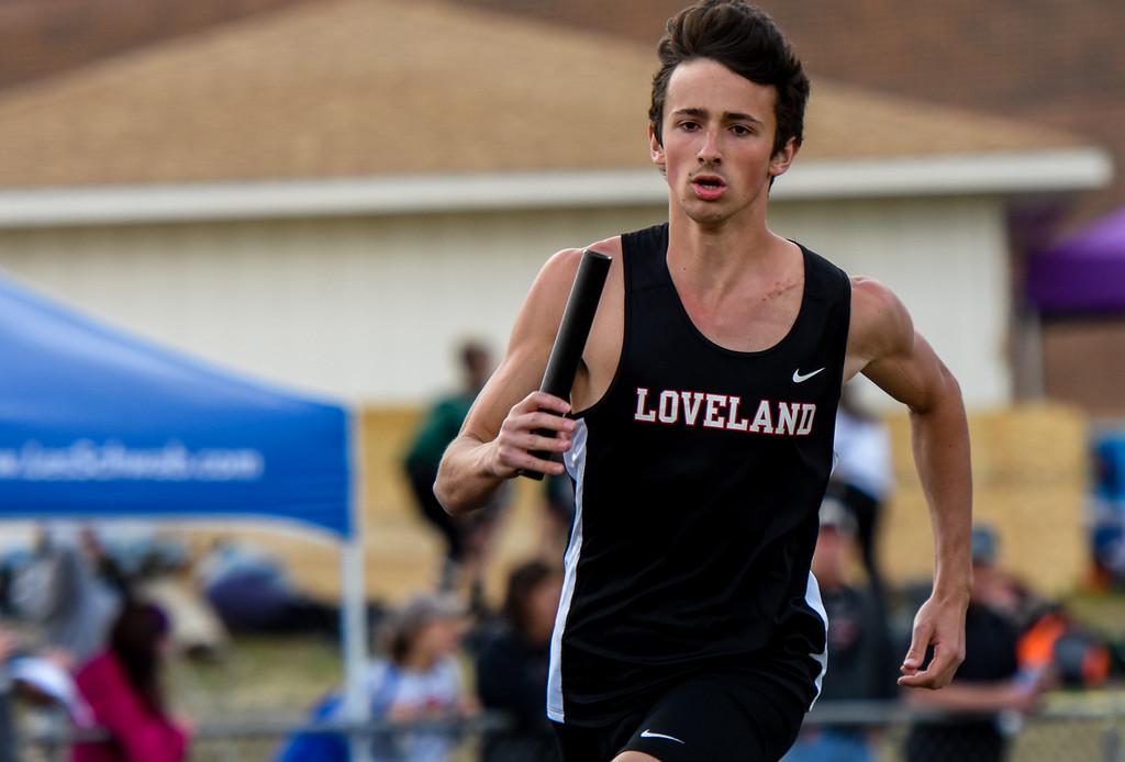 . Loveland\'s Adam Stark runs his leg of the 1,600-meter relay during the R2J Meet on Thursday April 12, 2018 at LHS. (Cris Tiller / Loveland Reporter-Herald)