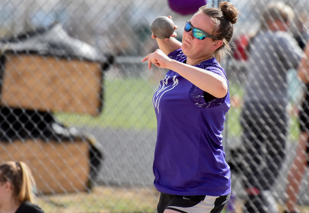 . Mountain View\'s RaLeigh Basart competes in the shot put during the R2J Meet on Thursday April 12, 2018 at LHS. (Cris Tiller / Loveland Reporter-Herald)