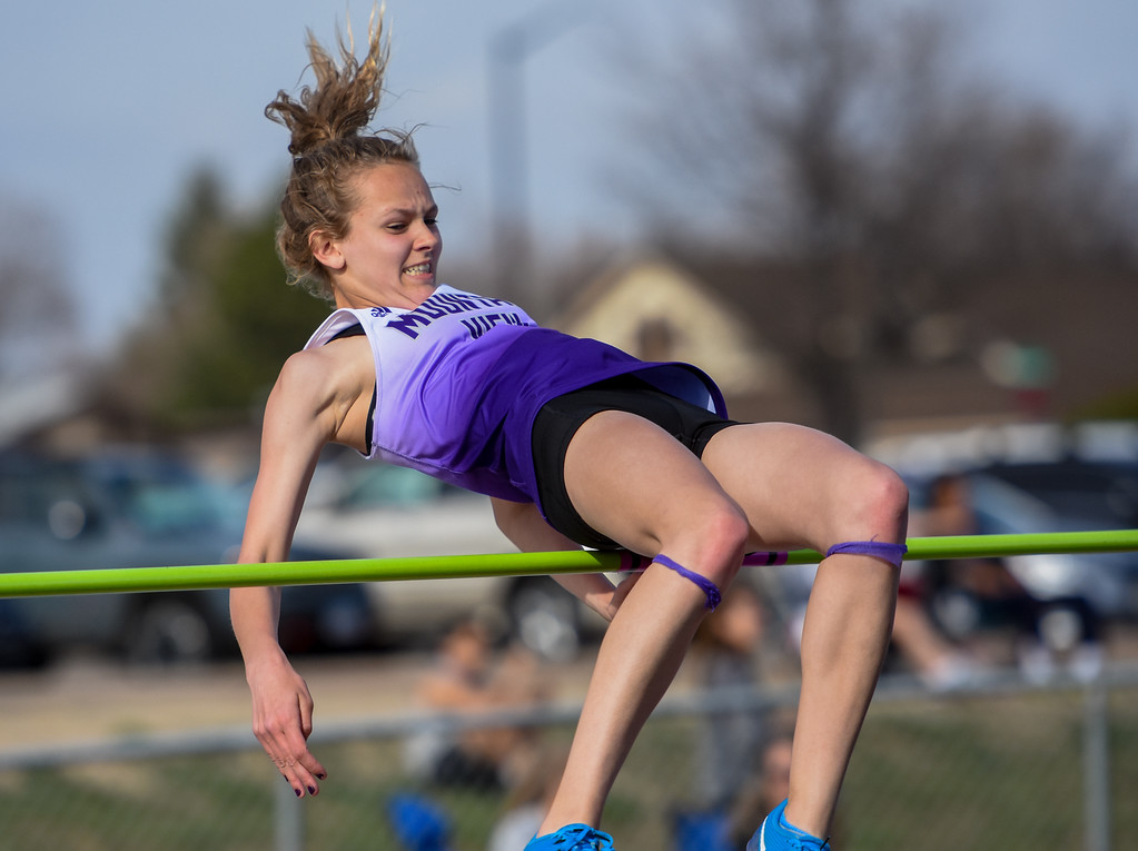 . Mountain View\'s Laurene Powell just misses clearing the high jump bar during the R2J Meet on Thursday April 12, 2018 at LHS. (Cris Tiller / Loveland Reporter-Herald)