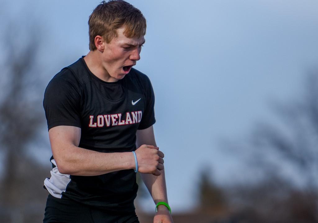 . Loveland\'s Mason Adams shouts after clearing the pole vault bar during the R2J Meet on Thursday April 12, 2018 at LHS. (Cris Tiller / Loveland Reporter-Herald)