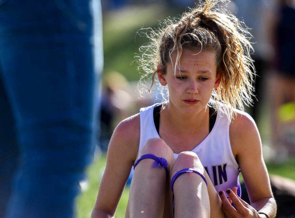 . Mountain View\'s Laurene Powell is saddened by missing her final high jump attempt during the R2J Meet on Thursday April 12, 2018 at LHS. (Cris Tiller / Loveland Reporter-Herald)