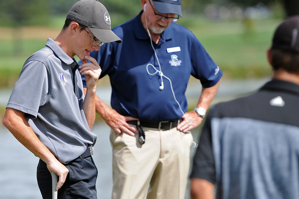 . Mountain View\'s Gavin McWhorter takes a look at his lie on the 14th hole during 4A Region 3 Tournament at the Olde Course at Loveland on Wednesday, Sept. 19, 2018. (Sean Star/Loveland Reporter-Herald)