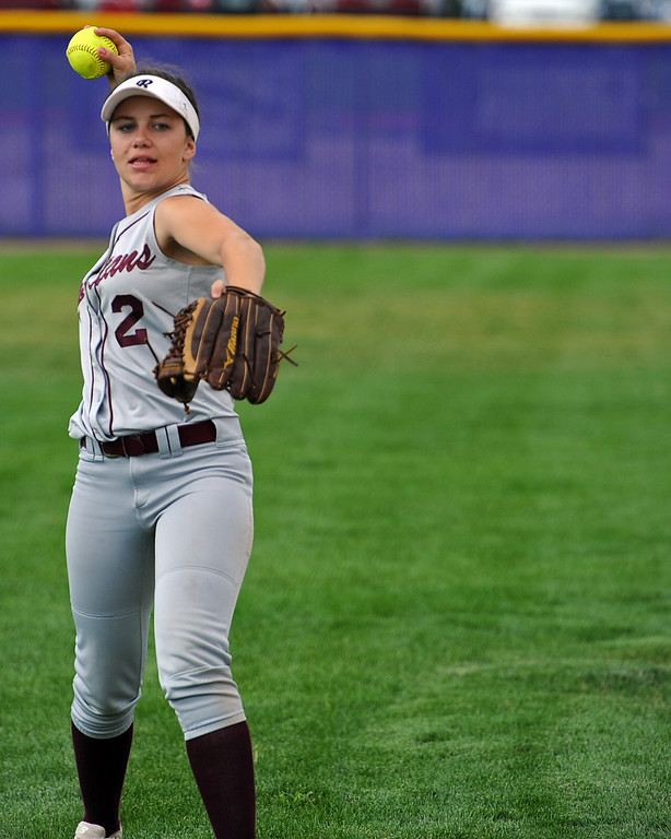 . Berthoud\'s Sophie Supernor warms up between innings during a game Tuesday, September, 11, 2018 at Holy Family High School in Broomfield, Colorado. (Sean Star/Loveland Reporter-Herald)