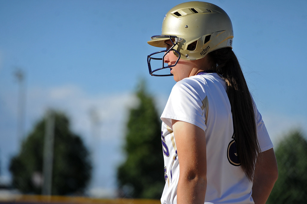. Holy Family\'s Erin Caviness looks to the third base coach during a game Tuesday, September, 11, 2018 at Holy Family High School in Broomfield, Colorado. (Sean Star/Loveland Reporter-Herald)