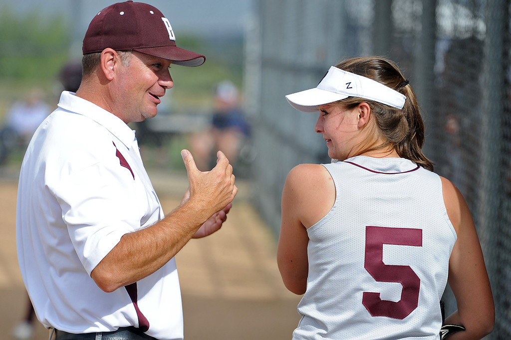 . Berthoud coach Buddy Kouns talks with Ellie Yuska between innings during a game Tuesday, September, 11, 2018 at Holy Family High School in Broomfield, Colorado. (Sean Star/Loveland Reporter-Herald)