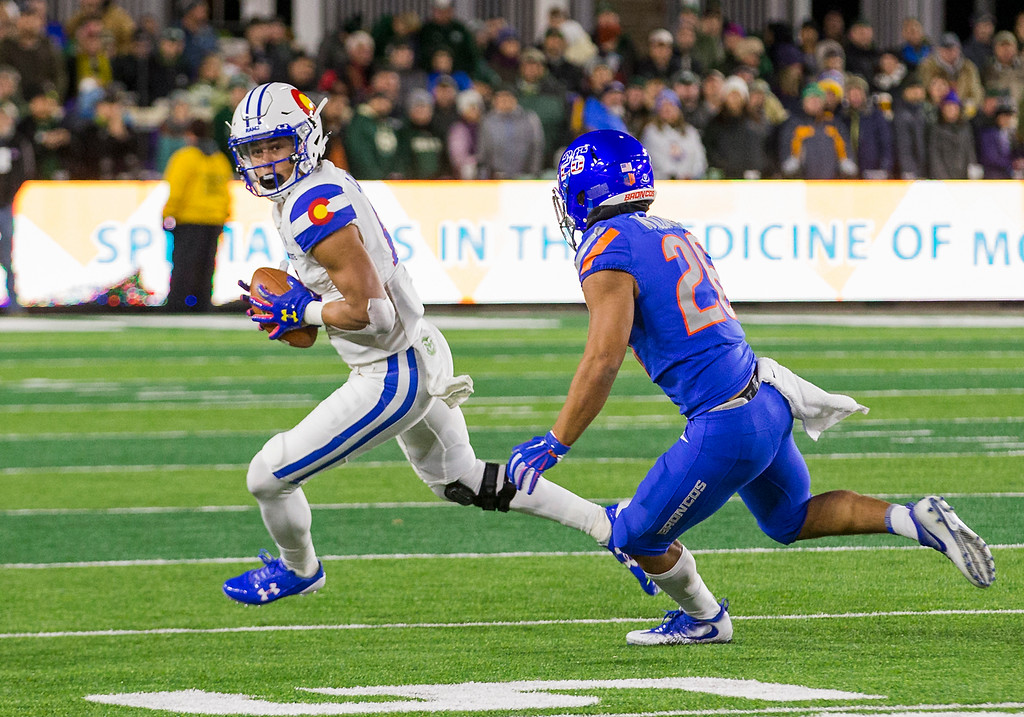 . Colorado State wide receiver Olabisi Johnson (81) turns the ball upfeild after a catch against Boise State\'s Avery Williams (26) Saturday evening Nov., 11, 2017, at the CSU Stadium in Fort Collins. (Michael Brian/For the Reporter-Herald)