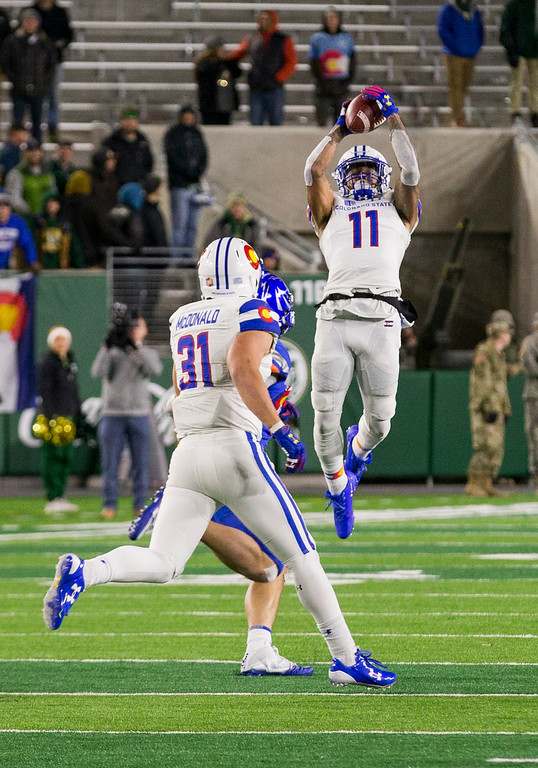 . Colorado State safety Jordan Fogal (11) leaps high in the air to grab an interception against Boise State late in the fourth quarter Saturday evening Nov., 11, 2017, at the CSU Stadium in Fort Collins. (Michael Brian/For the Reporter-Herald)