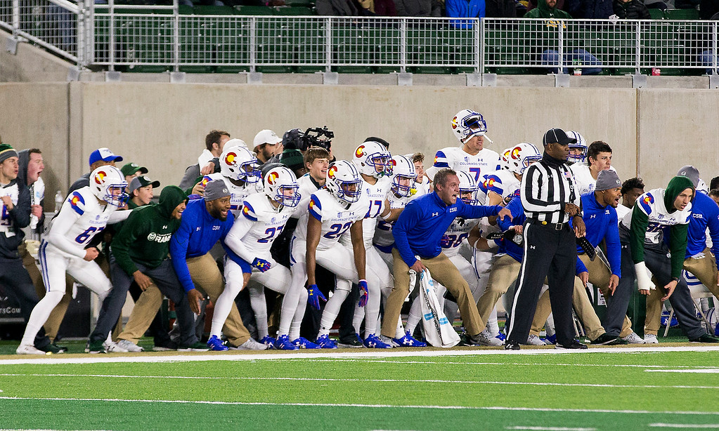 . The Colorado State sideline gets low during a kickoff against Boise State Saturday evening Nov., 11, 2017, at the CSU Stadium in Fort Collins. (Michael Brian/For the Reporter-Herald)