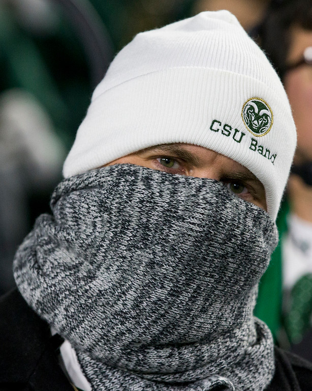 . A member of the Colorado State Band tries to keep warm as the Rams face the Boise State Broncos Saturday evening Nov., 11, 2017, at the CSU Stadium in Fort Collins. (Michael Brian/For the Reporter-Herald)