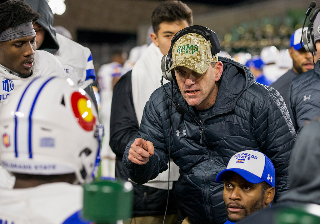 . Colorado State head coach Mike Bobo talks to his offense late in the fourth quarter as the Rams faced the Boise State Broncos Saturday evening Nov., 11, 2017, at the CSU Stadium in Fort Collins. (Michael Brian/For the Reporter-Herald)