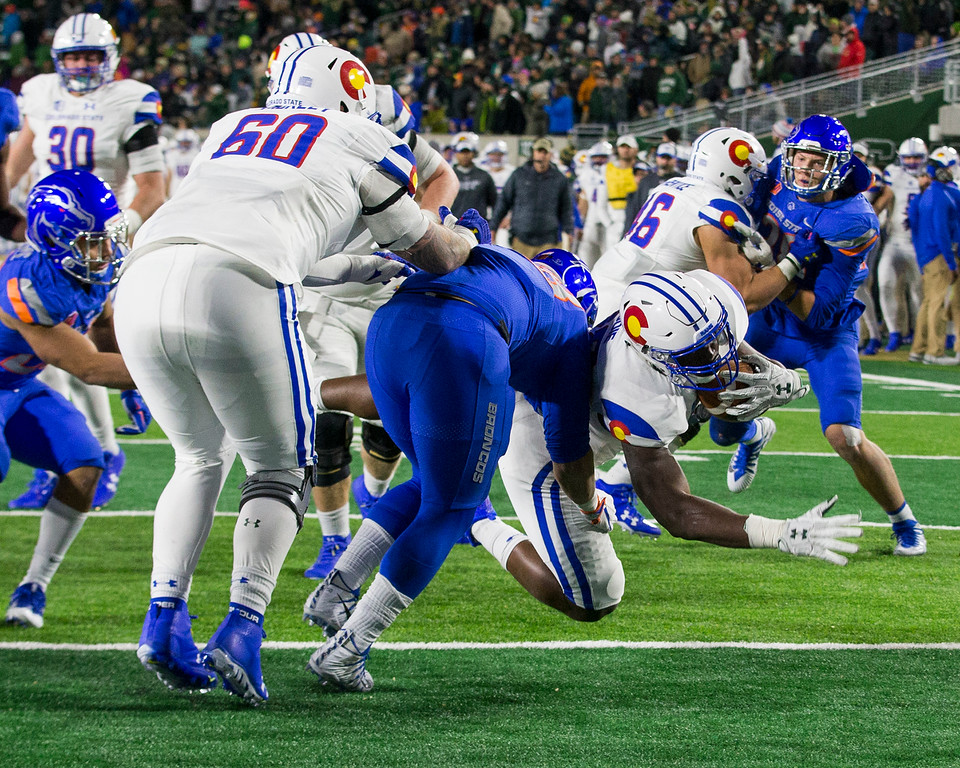 . Colorado State running back Rashaad Moddie (28), right, dives into the end zone to put the Ram\'s up by two touchdowns late in the fourth quarter against Boise State Saturday evening Nov., 11, 2017, at the CSU Stadium in Fort Collins. (Michael Brian/For the Reporter-Herald)
