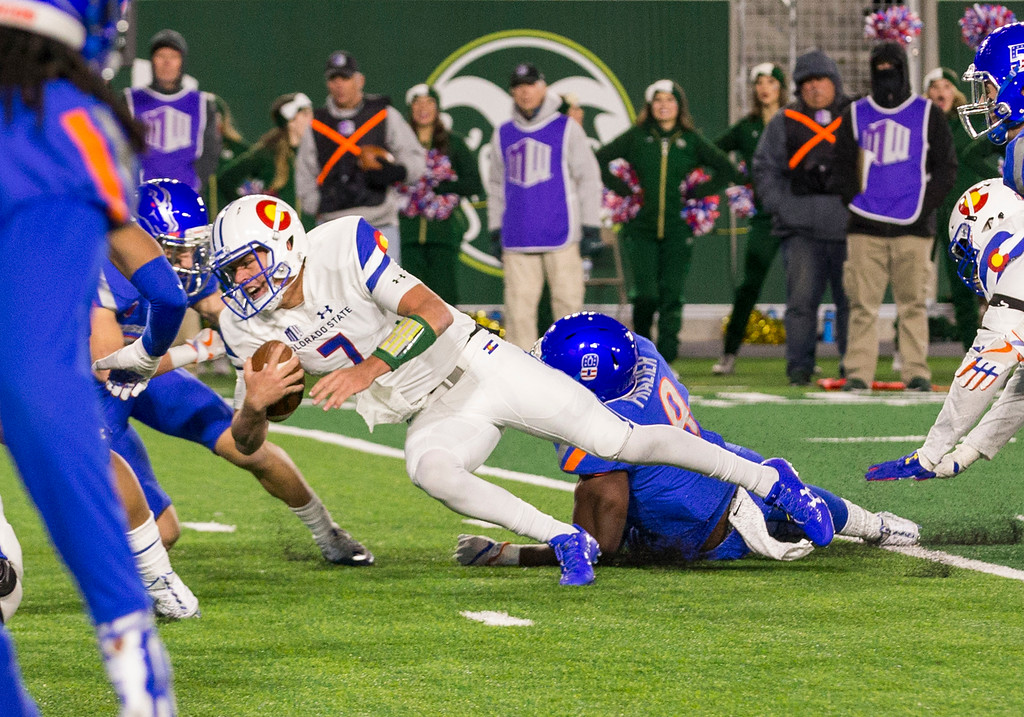 . Colorado State quarterback Nick Stevens (7) dives forward after scrambling from the pocket late in the fourth quarter against Boise State Saturday evening Nov., 11, 2017, at the CSU Stadium in Fort Collins. (Michael Brian/For the Reporter-Herald)