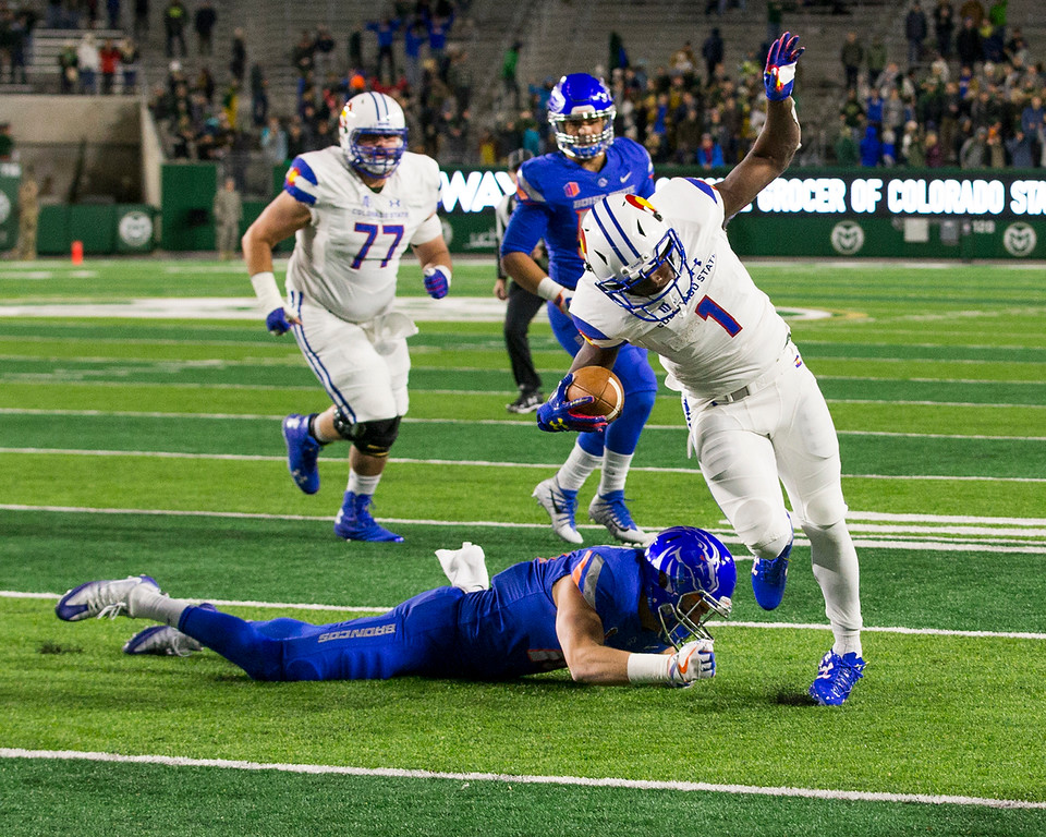 . Colorado State running back Dalyn Dawkins (1) avoids the tackle from Boise State\'s Kekoa Nawahine (10) on his way to the Ram\'s first touchdown Saturday evening Nov., 11, 2017, at the CSU Stadium in Fort Collins. (Michael Brian/For the Reporter-Herald)