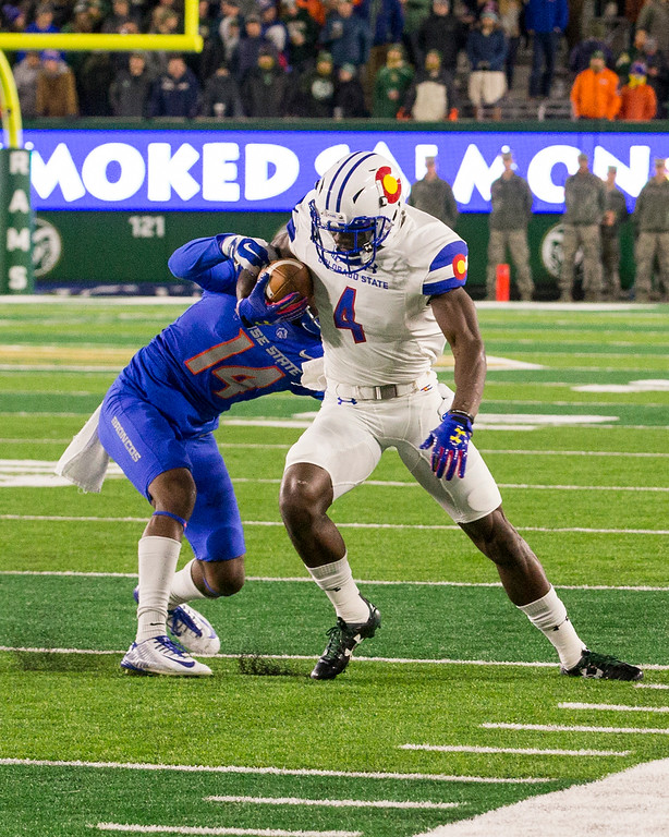 . Colorado State wide receiver Michael Gallup (4) fights for yards after the catch against Boise State\'s Tyler Horton (14) Saturday evening Nov., 11, 2017, at the CSU Stadium in Fort Collins. (Michael Brian/For the Reporter-Herald)