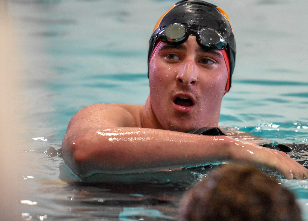 . Thompson Valley\'s Michael Vierra takes a deep breath after finishing the 500-yard freestyle during the City Swim Meet on Wednesday April 11, 2018 at the MVAC. (Cris Tiller / Loveland Reporter-Herald)