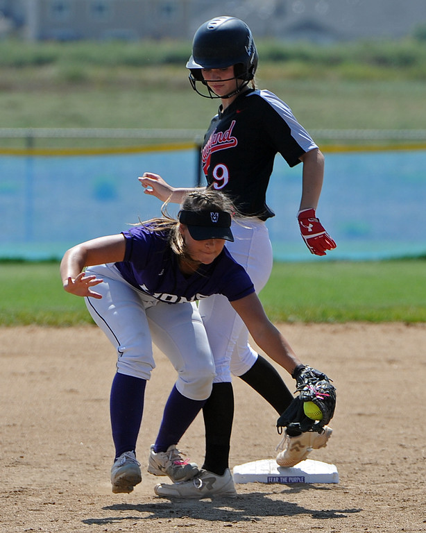 . Mountain View\'s Morgan Jewell scoops a throw as Loveland\'s Sage Baldwin makes it safely to second base during a game Saturday, Sept. 8, 2018 at Mountain View High School in Loveland. (Sean Star/Loveland Reporter-Herald)